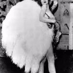 American actress and dancer Faith Bacon with feather fan