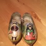 Clogs decorated with male and female figures