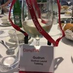 A wine glass and a name badge