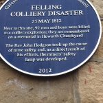 A blue plaque commemorating the lives lost at Felling Pit