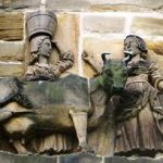 A carving of a cow, a milkmaid and a monk which is on a wall at Durham Cathedral