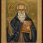 An illustration of St Benedict. He is wearing a cloak and holding a book and a staff