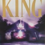 The front cover of Stephen King's From a Buick 8, showing a car in a garage. Both are lit by purple light