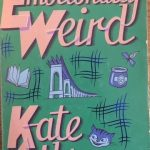 The front cover of Emotionally Weird by Kate Atkinson, showing a cat, a book, a pot of jam and a bridge