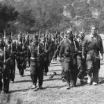 Rows of soliders in a field. Black and white image from Spanish Civil War