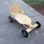A toy wooden cart