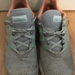 A pair of grey Adidas running shoes