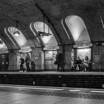 A black and white photo of the arched windows along a platform at Baker Street tube station