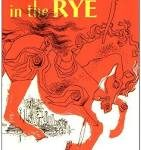 An orange carousel horse with the title The Catcher in the Rye in yellow letters above it