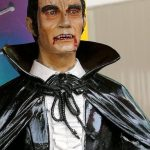 A statue of Count Dracula, wearing a black cape