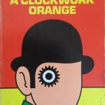 Cover of a Clockwork Orange, showing a face with no features other than a cog for an eye. The head is wearing a bowler hat