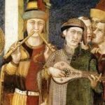 A medieval man playing two flutes, dressed in a red and yellow gown. Beside him, a man in a grey and green gown plays a lute