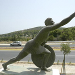 A statue of Pheidippides, who ran from Marathon to Athens. He is shown with a shield and one arm outstretched