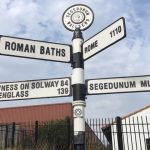 Signposts outside Segedunum Roman Fort, pointing to the baths and Rome