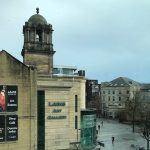 The Laing Art Gallery - a sandstone building with tower and a green glass entrance lobby