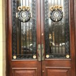Two wooden doors with glass panels