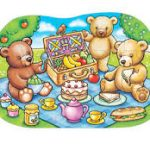 A cartoon of teddy bears having a picnic, seated on a blue rug with a hamper and food.