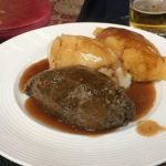 A photo of a plate of haggis, neeps and tatties with gravy